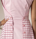 Pullover, back wrap dress (fitted through bust) has bodice front extending to side back, self-lined midriff, skirt extending to side back, no side seams, concealed elastic with hook and eye closure, and narrow hem. A: Back button closing. B: Back tie ends. Note: No provisions provided for above waist adjustment.Designed for lightweight woven fabrics.
