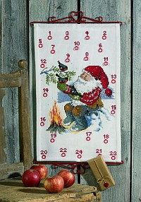 White christmas gift calendar with Santa by the fire. Permin 34-9250.