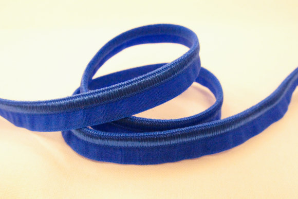 Elastic piping, royal blue
