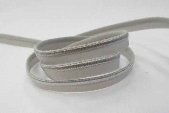 Elastic piping, grey