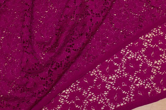 Fuchia-colored, soft lace with stretch along farbric