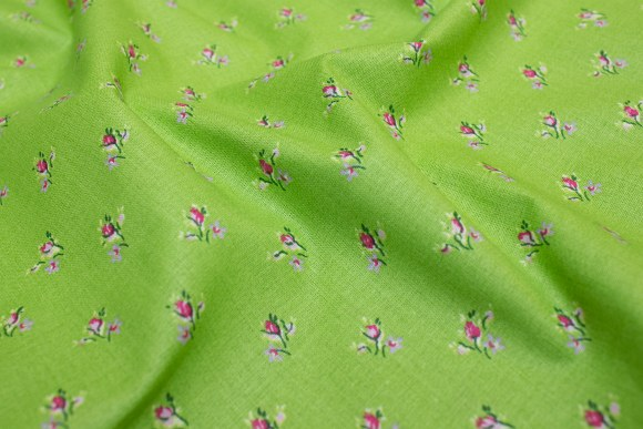 Light green cotton with small pink flowers