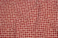 Red and white checked cotton and polyester with daisies