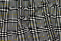 Black and white stretch-checks with brass-yellow stripe