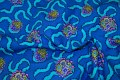 Clear blue cotton with turqoise printed drape and flowers.
