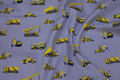 Grey, woven cotton with yellow excavators.