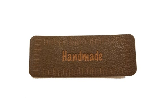 Handmade brown leather-look iron on patch 6 x 2 cm.