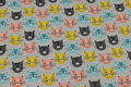 Light grey-speckled, light sweatshirt fabric with cat-heads.