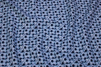 Light grey, woven cotton with lots of soccer balls