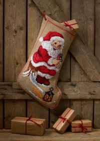 Christmas sock with Santa on tree trunk. Permin 41-1234.