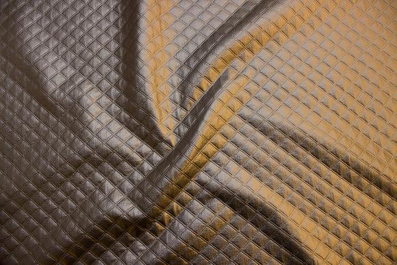 Præget quilt in sølvfarvet