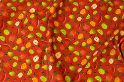 Tomato-red cotton-jersey with ca. 2 cm big fruits