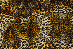 Viscose-jersey with animal-print in golden colors