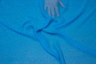 Turqoise-blue chiffon, some transparency.