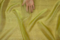 Transparent green-yellow organza . 6,56