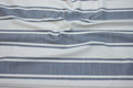 Off white and grey-blue opholstry fabric with wide stripes