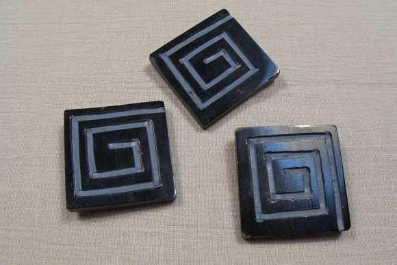 Rectangular hand-carved buttons, 4 x 4 cm.
