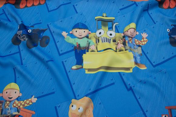 Blue darkening drape fabric with Construction worker Bob