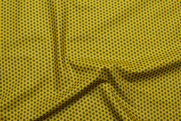 Curry yellow patchwork-cotton with dark 5 mm stars