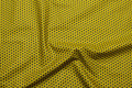 Curry yellow patchwork-cotton with dark 5 mm stars.