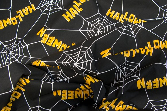 Halloween and spider webs on black cotton