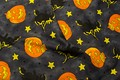 Pumpkin Halloween print on blue-grey cotton with witches.