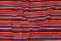 Woven fabric with mexico-stripes in red nuances
