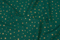 Cotton with goldstars - green. 6,56