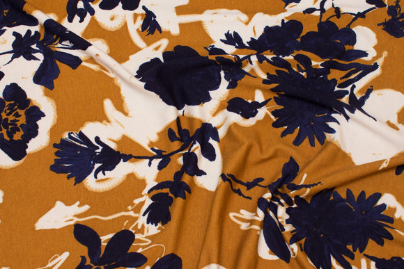 Lightweight viscosejersey in cinnamon-colored with navy and white flowers