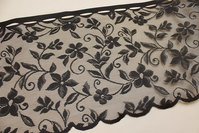 Black café-drape with flower-pattern, 35 cm tall