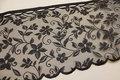 Black café-drape with flower-pattern, 35 cm tall.