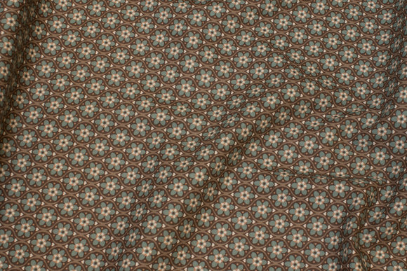 Dirt-colored retro-cotton with small jade-green motif