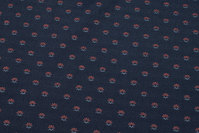 Furniture-jacquard in speckled navy with small koralfarvet motif