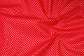 Rugged red deko-cotton with small gold-dots.