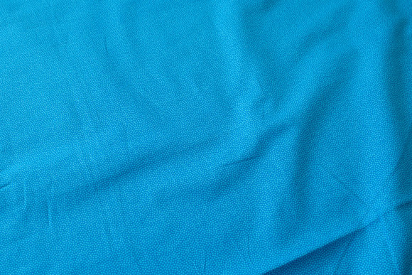 Small-dotted cotton blue-turqoise, nuance in nuance