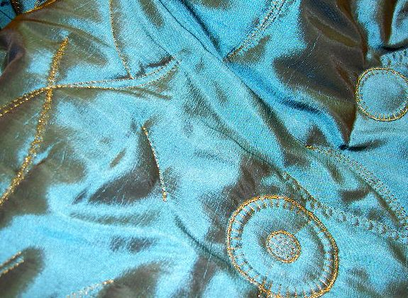 Taffeta with gold embroidery. Quilt