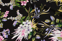 Black viscose mousselin with big, beautiful white, red and blue flowers