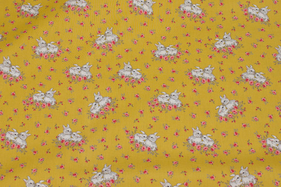 Brass-yellow firm cotton with rabbits