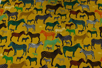 Brass-yellow, light sweatshirt fabric with ca. 3-10 cm zebras