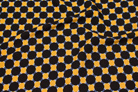 Brass-yellow viscose mousselin with 2½ cm black dots
