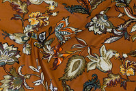Cinnamon-colored viscose-jersey with olive-colored flowers