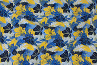 Cotton-jersey with ca. 4 cm leaves in blue and yellow