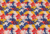 Cotton-jersey with ca. 4 cm leaves in blue, yellow and red