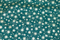 Dark green christmas-cotton with ca. 1-2 cm gold stars.