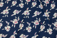 Dusty navy viscose-jersey with ca. 5 cm white flowers