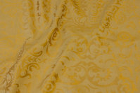Elegant jacquard-woven table-cloth-fabric in brass-golden