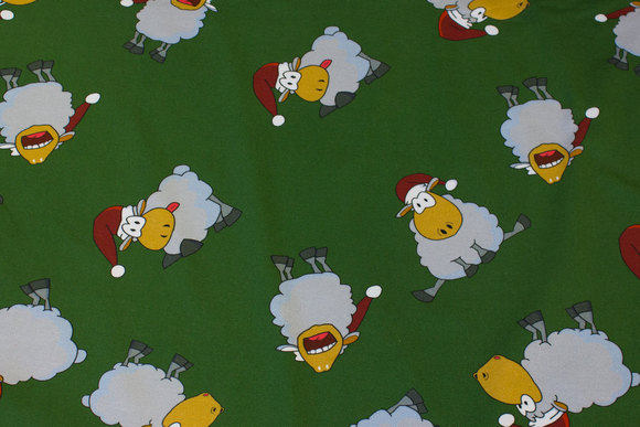 Green christmas-cotton-jersey with ca. 7 cm big elf-sheep