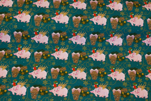 Green cotton-jersey with christmas-pigs and cones