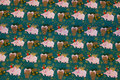 Green cotton-jersey with christmas-pigs and cones.