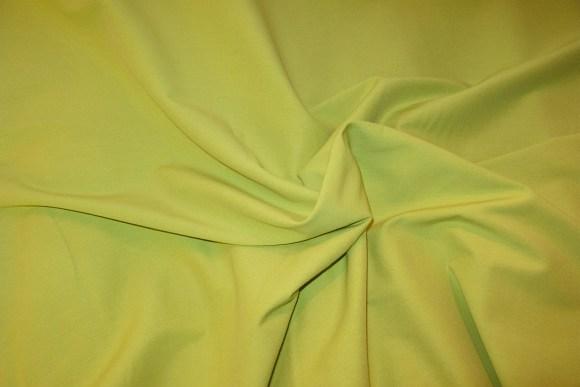 Kiwi-color stretch-poplin with stretch longitudinally